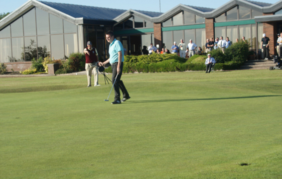 Fraser Macleod holes the winning putt.